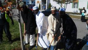 Imam Ceesay in white leading tree planting!