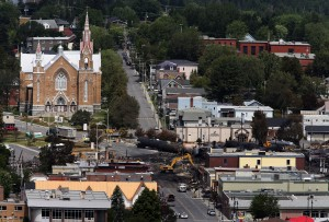 Workers begin digging at the site of a derailment in Lac Megantic Quebec