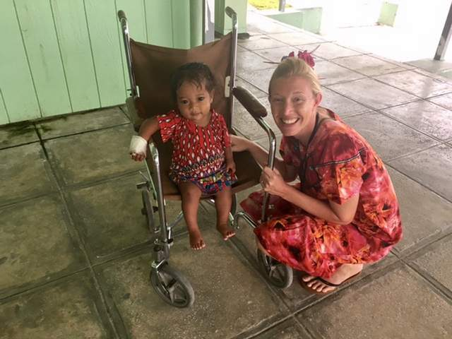 Kasey Patton with child at the hospital in Majuro