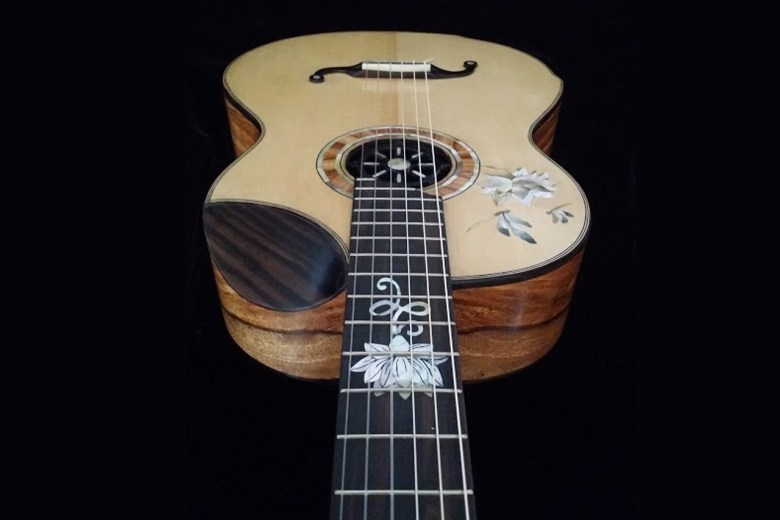 handcrafted guitars with ebony, spruce, inlay art, french polished
