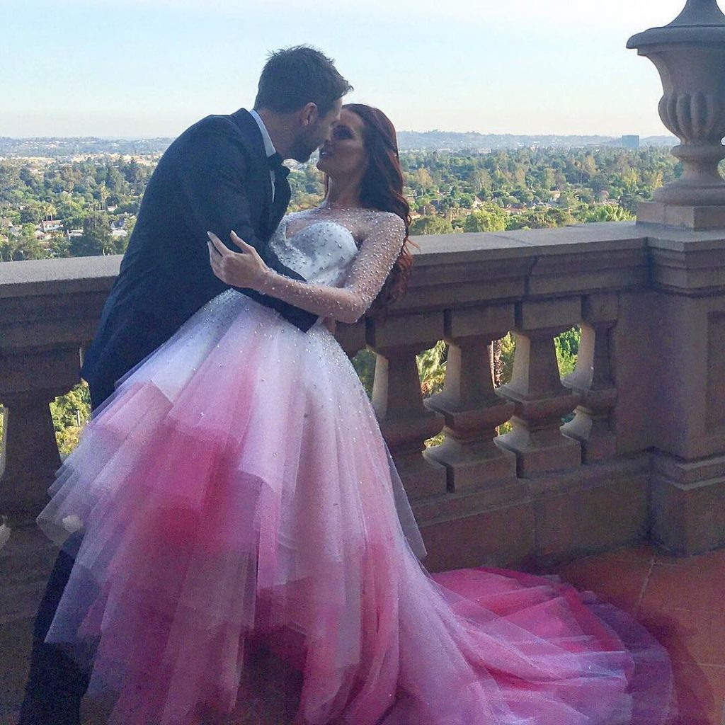 Hearst's dress flared out with the prettiest pink ombre tool. She wore it when she wed television host Chris Hardwick in August 2016.