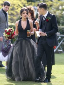 "The ""90210"" star went to the completely opposite of the color wheel with a black V-neck halter gown by Vera Wang when she wed musician Josh Beech in 2013."
