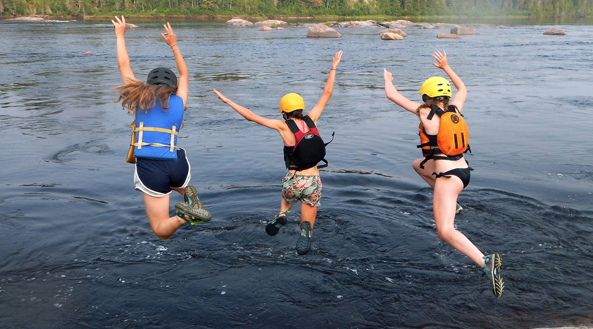 Girls jumping in water
