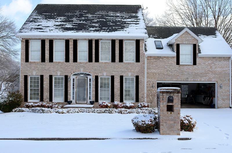 House-with-Black-Storm-Door-black-shutters
