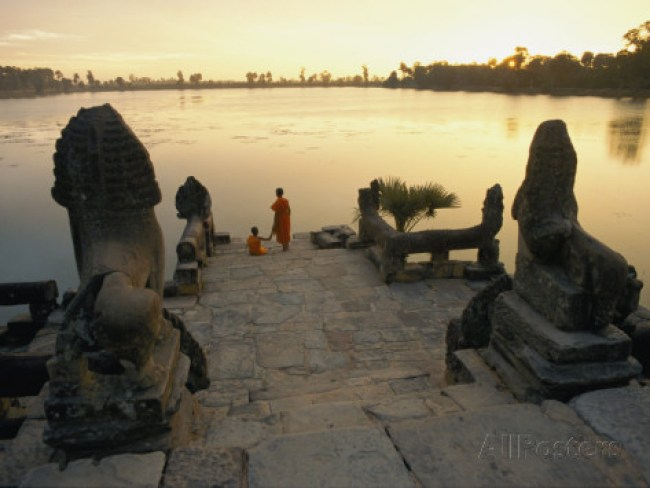paul-chesley-two-buddhist-monks-sit-at-the-waters-edge-at-a-lake-temple-in-the-angkor-wat-complex