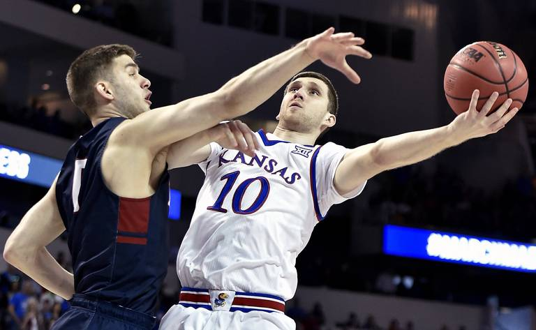 KU's Svi Mykhailiuk, right, drives to the bucket while being defended by Penn's Maz Rothschild during the first half of Thursday's game in Wichita.