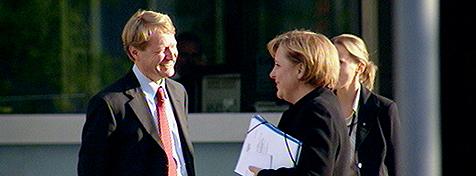 Merkel und Pressesprecher Walter