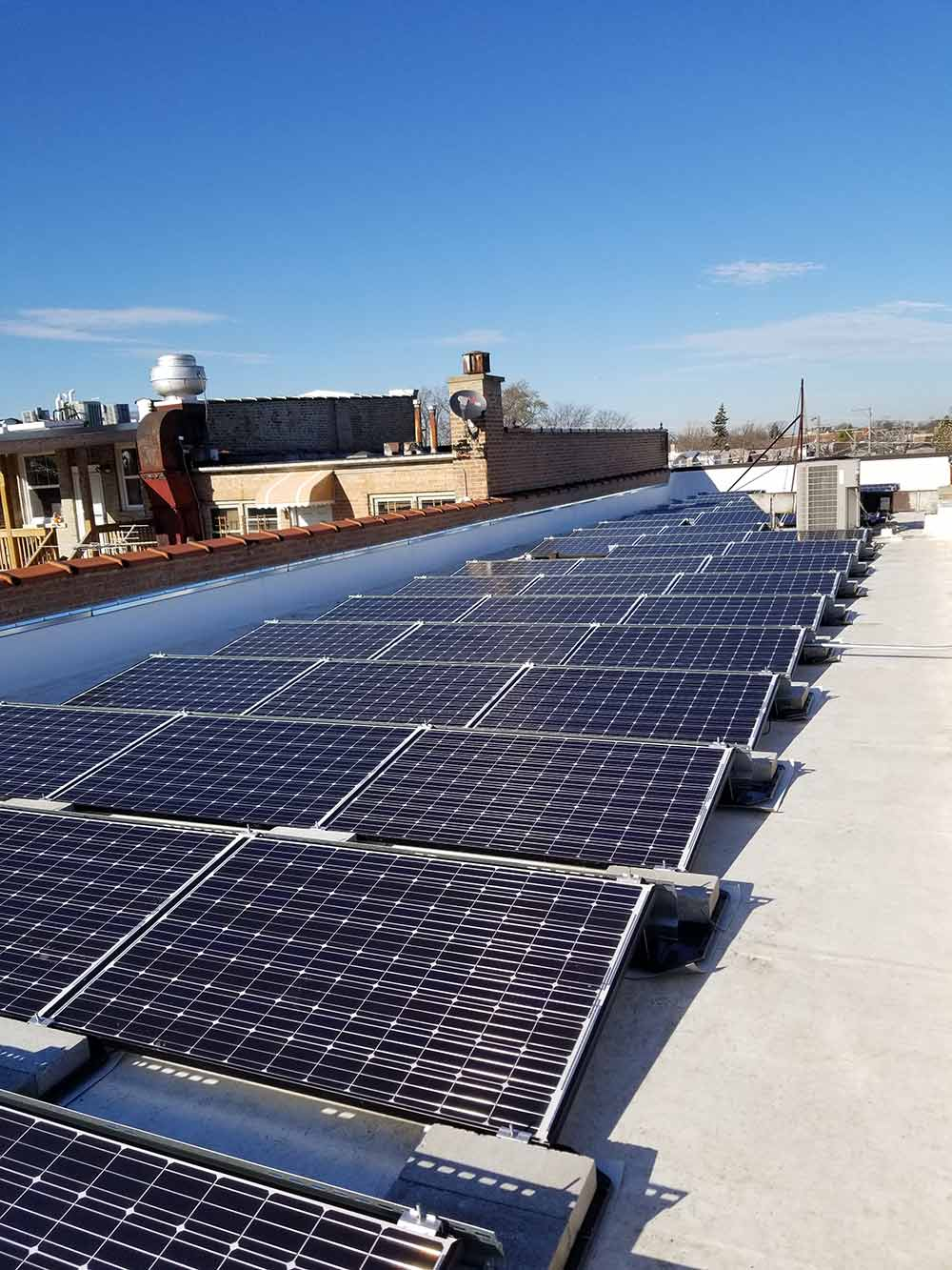 hight resolution of rows of solar panels on a roof
