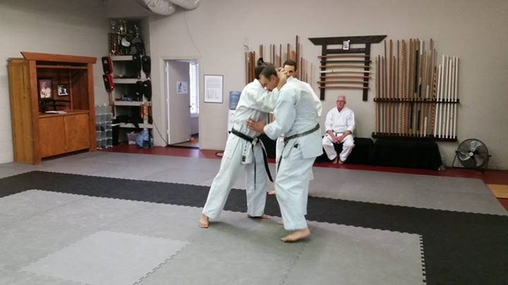 Ed Sumner watching Richard Poage teach a clinch drill