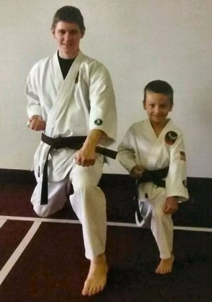 Myself as a brown belt at my old dojo, with one of our talented youth students