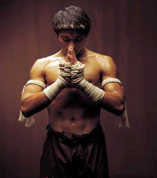 Tony Jaa, lead actor in the Ong Bak series of films, dressed in kard cheuk Muay Thai garb