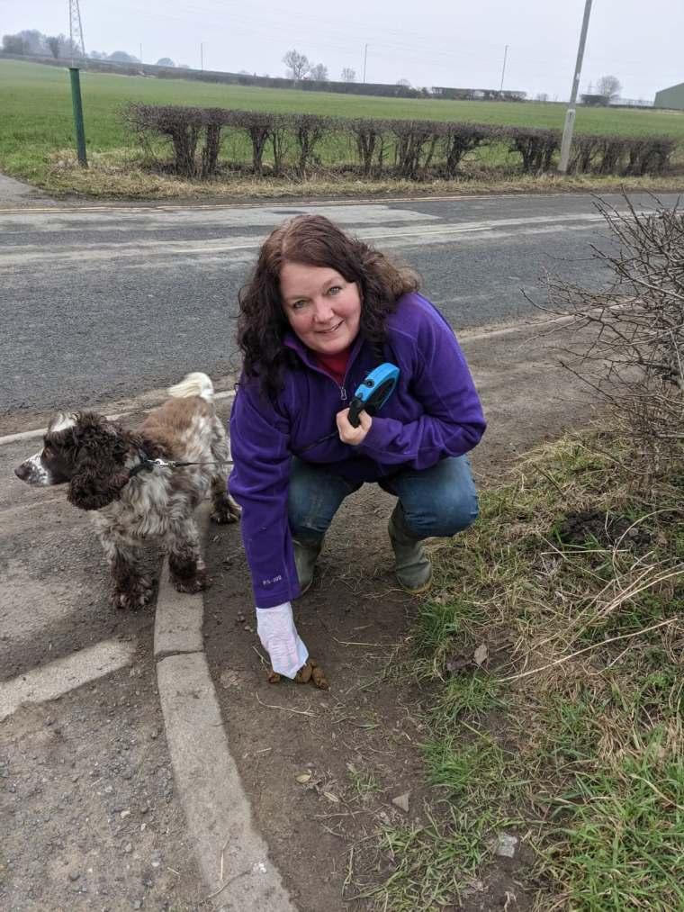 Karen Bruce picking up dog poo in Rothwell photo.