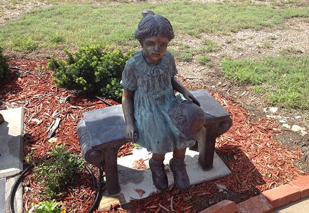 statue at Orphan Train Museum