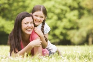 stockfresh_93362_mother-and-daughter-lying-outdoors-smiling_sizeXS-300x200