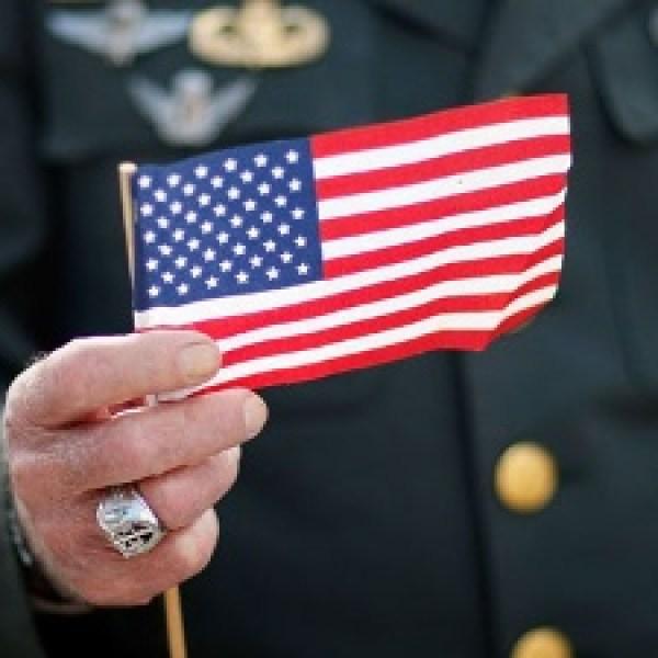 Veteran-holding-American-flag--Veterans-Day_20161111160548-159532-159532