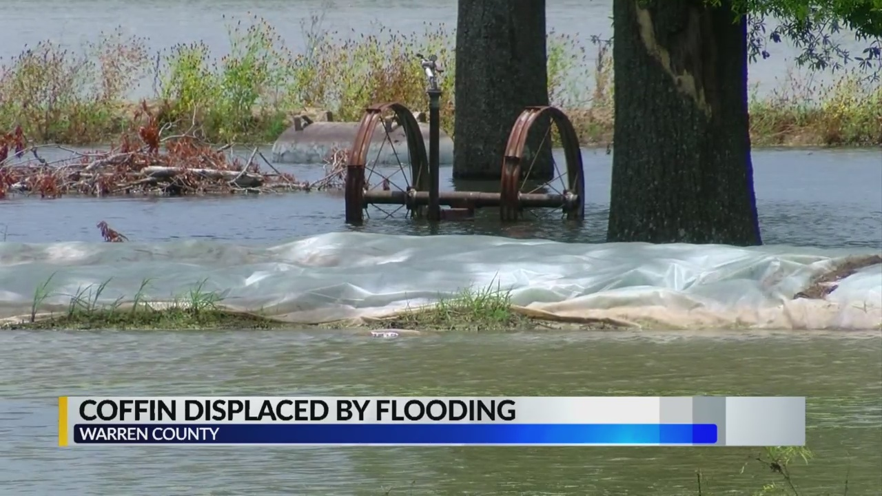 Coffin_displaced_by_floodwater_1_20190606221016-842162548