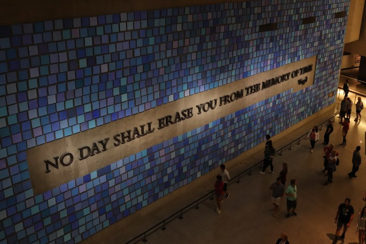 "A mural at the 9/11 museum which says ""No day shall erase you from the memory of time"" a quote by Virgil."