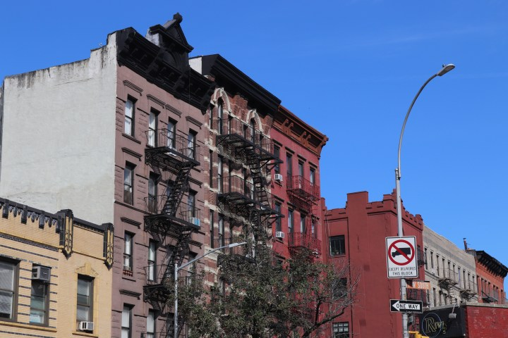 A picture of 20th century New York architecture with iron fire escapes on the facade.