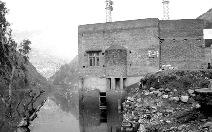 Floating Masjid: Rising water levels have partially submerged this masjid at Pul Doda