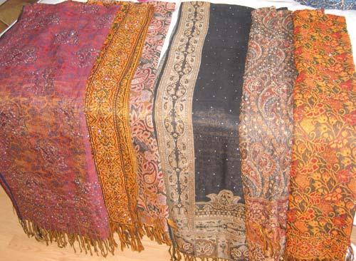 A variety of Kashmiri Pashmina shawls on display in a showroom in Srinagar.