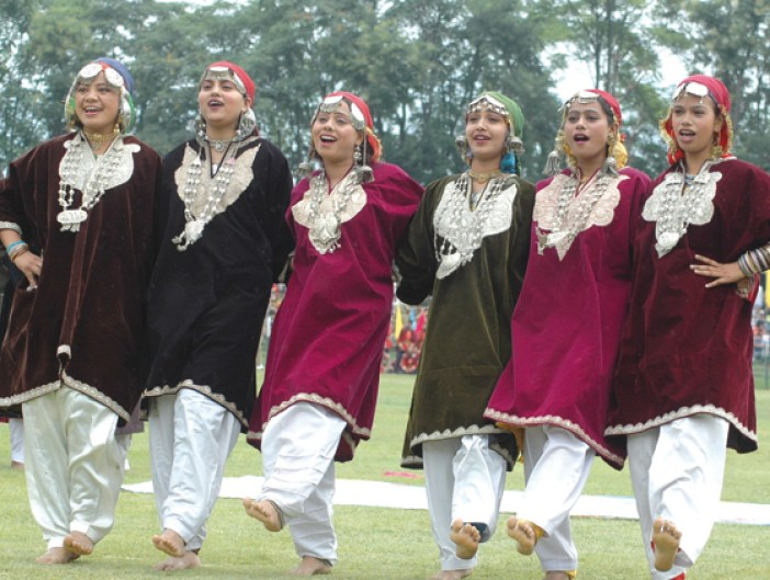 Kashmiri girls performing in traditional Pherans during a state organized function.  Pic: Bilal Bahadur