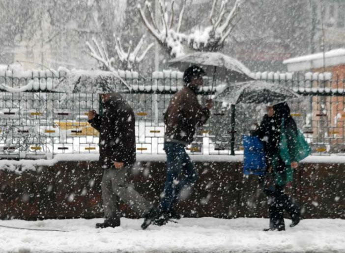 Passing On: People walking pass each in Srinagar