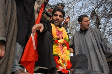 NC's candidate for Rajpora Ghulam Mohiuddin Mir during a road show in Bellow area.