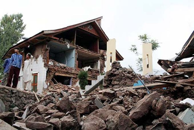A collapsed house in 2005 earthquake in Uri. File Pic