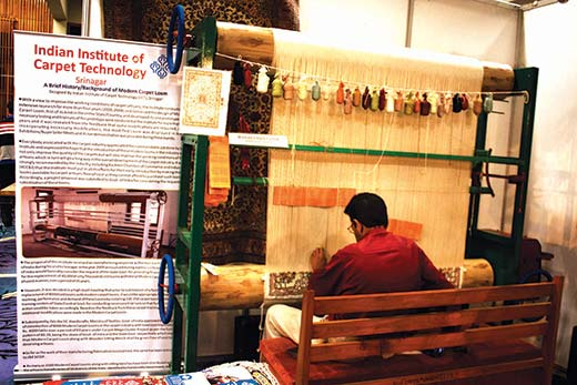 Manzoor Ahmad Bhat weaving carpet at International Buyer Seller Meet. Pic: Durdana Bhat