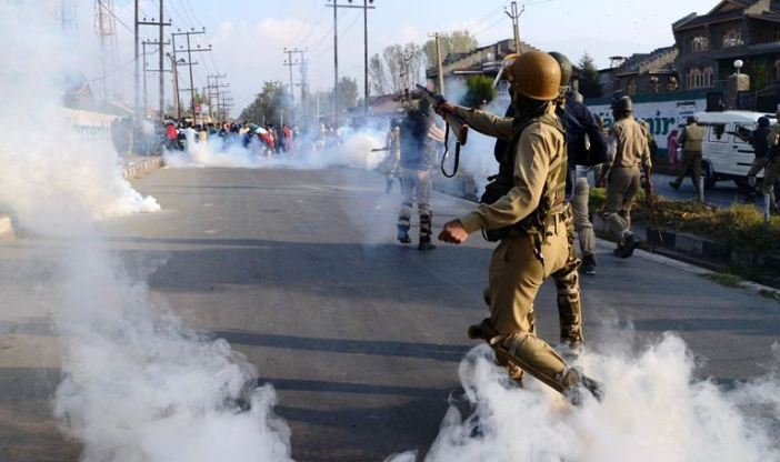 In this file photo, forces firing tear gas shells on the funeral of 12 year old slain Junaid Ahmad Akhoon near Aali Masjid Srinagar on the morning Oct 8th 2016.
