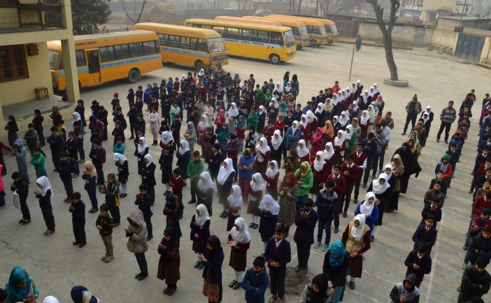 Students attending morning assembly at a school in Pampore.