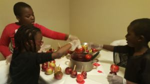 My children making candy apples
