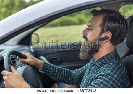 stock-photo-young-man-speaking-on-the-mobil-phone-using-headset-488772412