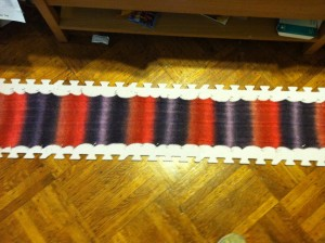 Here is the finished scarf blocking in my living room floor.