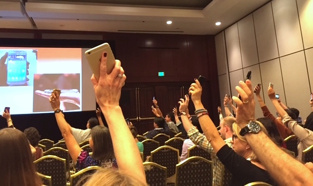 The Online News Association's annual conference Sept. 24 - 26 drew more than 2,000 attendees who wanted to learn about digital journalism. During a presentation by Wall Street Journal Executive Mobile Editor David Ho, audience members raised their phones to drive home the point about how ubiquitous smart phones are today. Photo by Kate Nash Cunningham