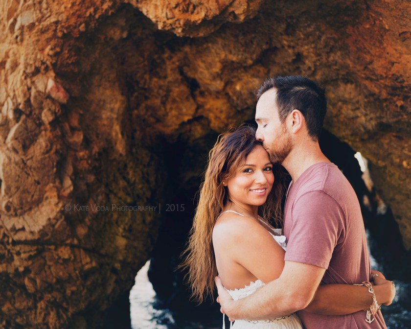 engaged couple kissing on beach, engagement session on beach