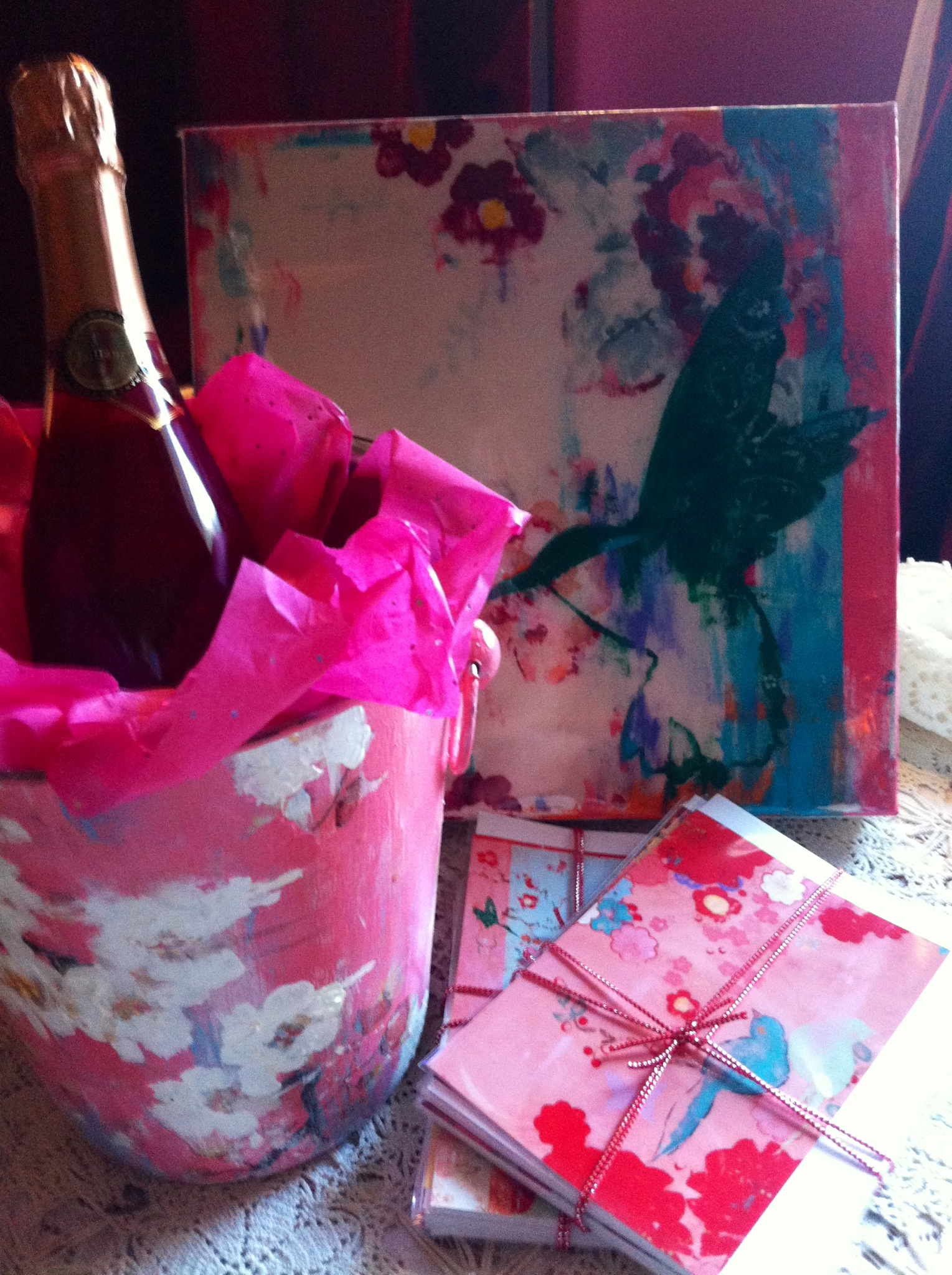 "Wine bucket with ""Pink Kiss"" painting, pink champagne and two sets of Kathe Fraga greeting cards."