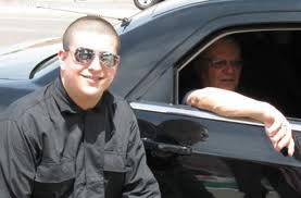 Arpaio (in car) and Lombardi