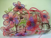 laminated-structure-with-hand-stitched-plastic-flowers-small