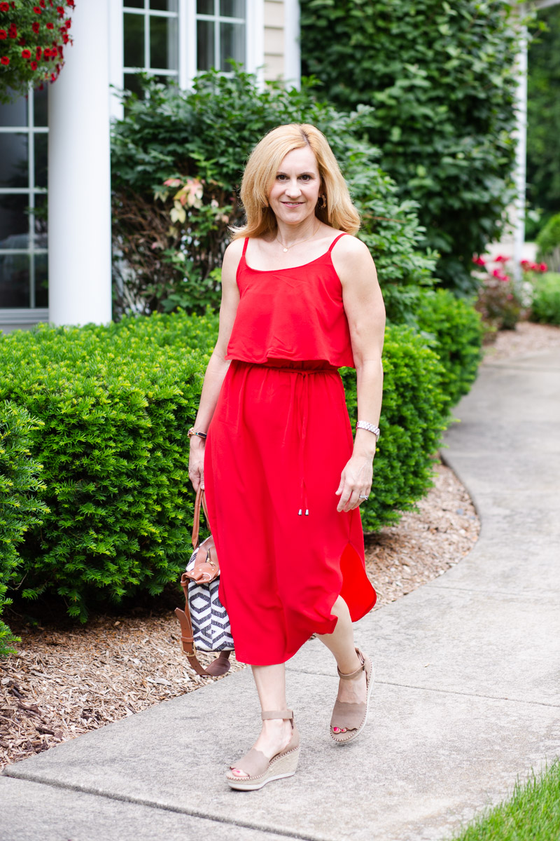 Wearing a budget-friendly midi dress that is perfect for summer.