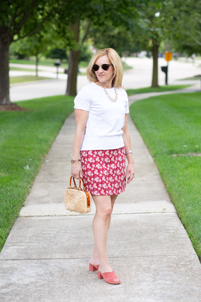Changing up a red printed mini dress by adding a short sleeved tee over it.