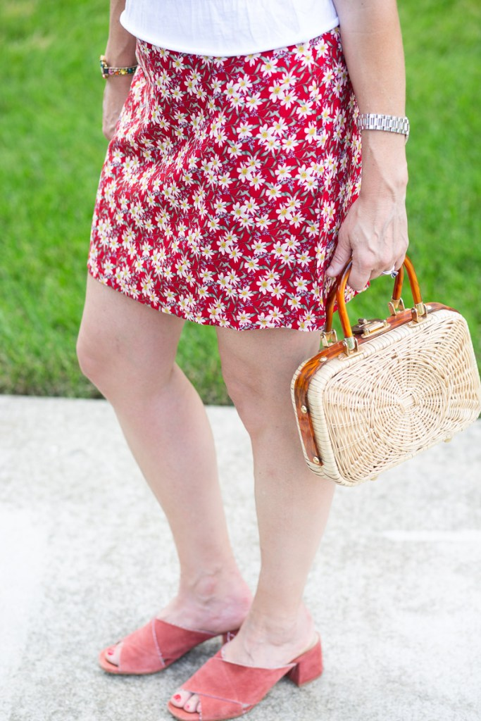 Layering a short sleeve white tee over a red printed dress.