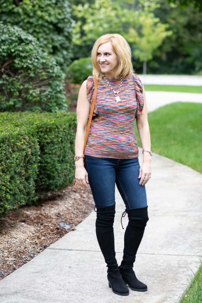A transitional summer to fall look featuring a flutter sleeve sweater with skinny jeans and over the knee boots.
