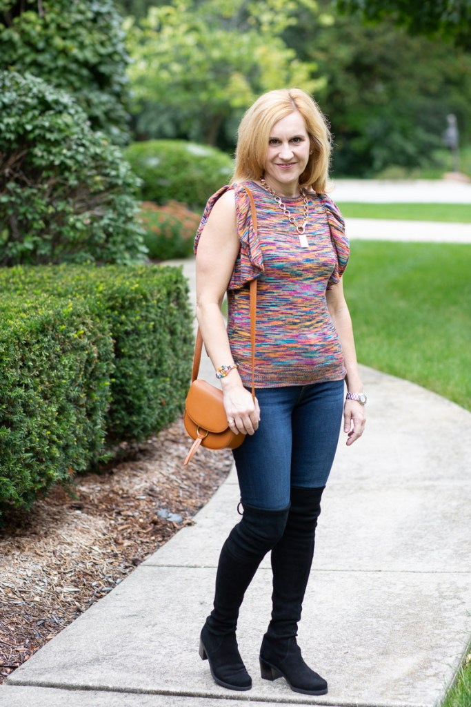 Colorful flutter sleeve sweater with skinny jeans and over the knee boots.