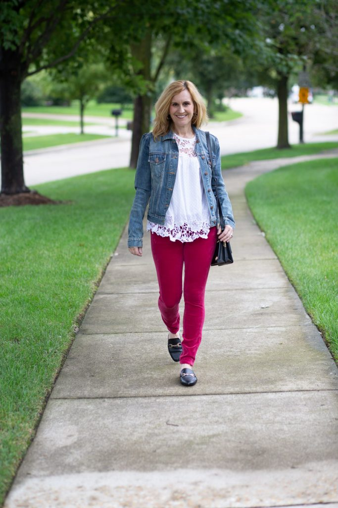 Wearing pink corduroy jeans with a lace tank and denim jacket.