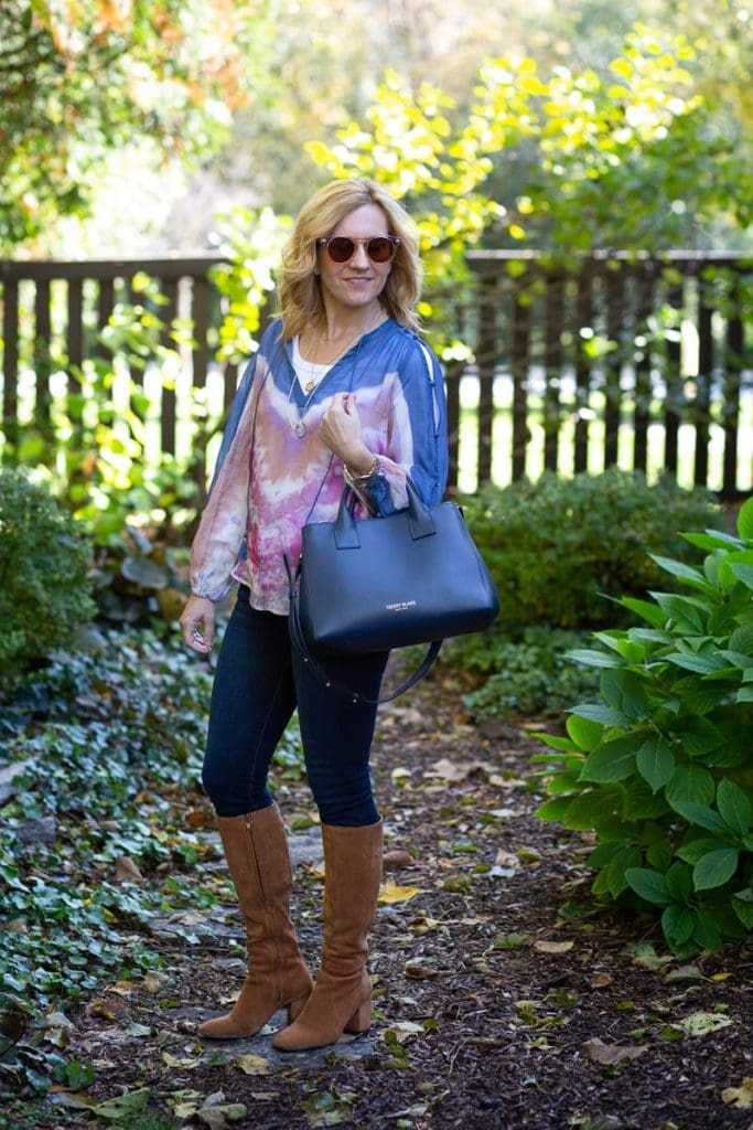 A boho chic look featuring a tie-dyed blouse.
