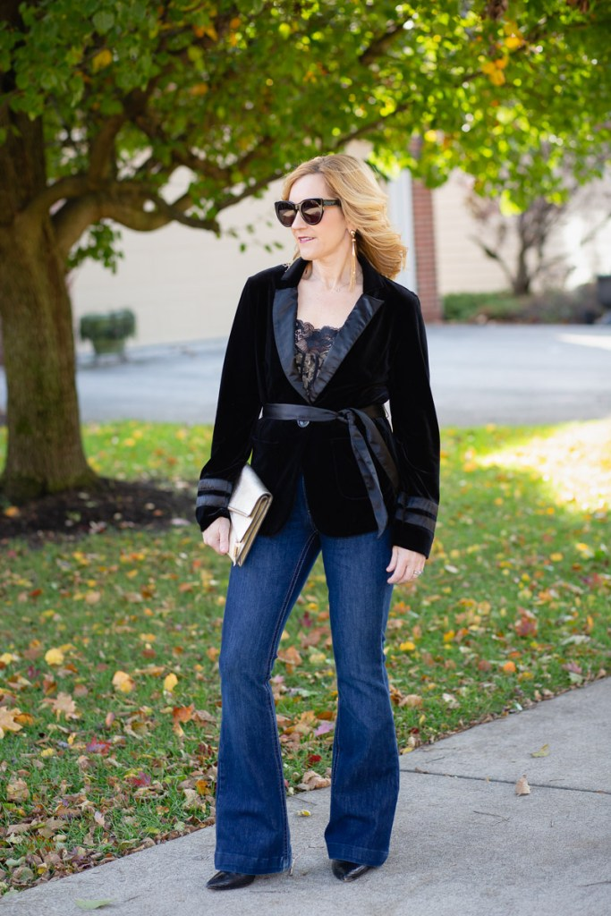 A holiday look featuring a velvet blazer and flared jeans.