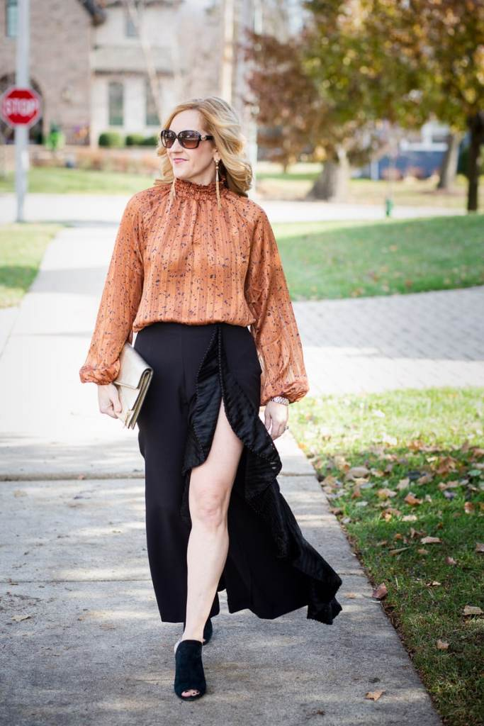 Pairing a mock neck long sleeve bodysuit with ruffle pants.