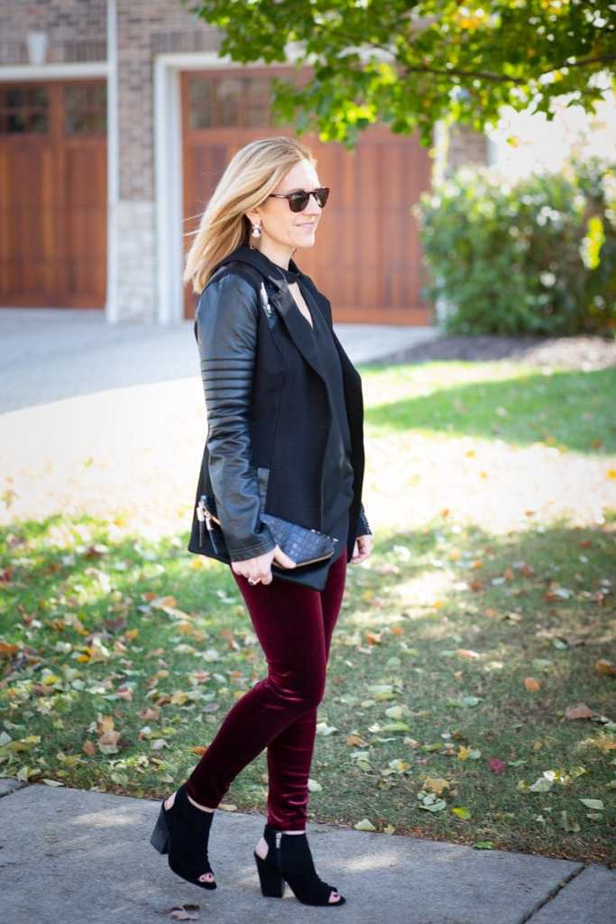An edgy holiday look featuring a moto jacket and velvet leggings.