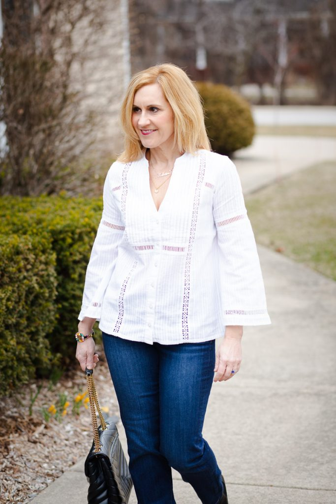 A white blouse and dark jeans by Liverpool Los Angeles.
